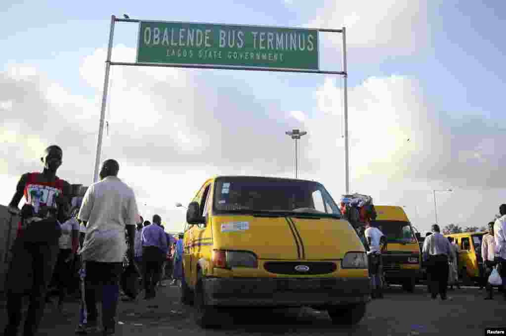 A vehicle used for commercial transportation is driven through a motor park in the Obalende district of Lagos.