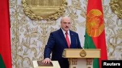 На фото: заприсяження Лукашенка