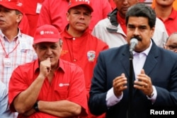 FILE -- Venezuela's Oil Minister and President of the Venezuelan state oil company PDVSA, Eulogio del Pino stands next to Venezuela's President Nicolas Maduro during a pro-government rally with workers of state-run oil company PDVSA in Caracas, Venezuela,