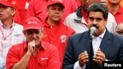 "FILE -- Venezuela's Oil Minister and President of the Venezuelan state oil company PDVSA, Eulogio del Pino stands next to Venezuela's President Nicolas Maduro during a pro-government rally with workers of state-run oil company PDVSA in Caracas, Venezuela. Maduro's political opponents have accused him of staging a ""coup d'etat"" by stopping the effort to hold a vote to remove him."