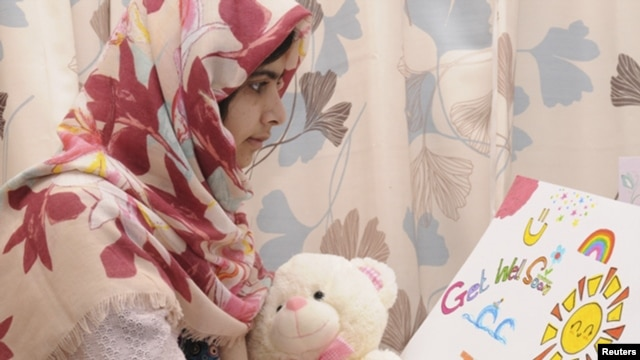 Pakistani schoolgirl Malala Yousufzai reads a card as she recuperates at the The Queen Elizabeth Hospital in Birmingham in this undated handout given to Reuters on November 8, 2012.