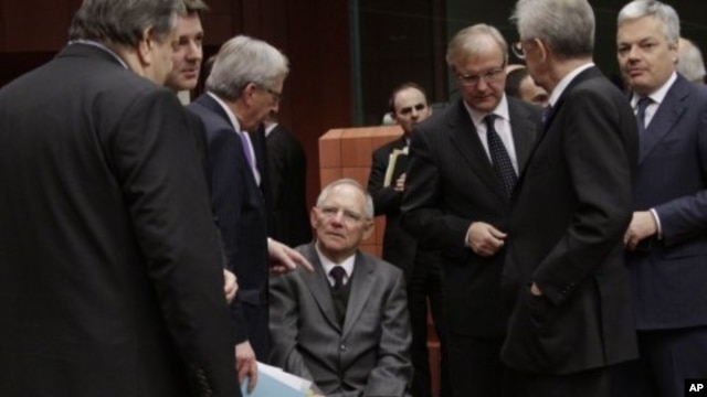 From left, Greek Finance Minister Venizelos, French Finance Minister Baroin, Luxembourg's PM Juncker, German Finance Minister Schaeuble, European Commissioner for the Economy Olli Rehn, Italian PM and Finance Minister Mario Monti and Belgium's Finance Min