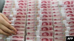 FILE - China's yuan will become Zimbabwe's reserve currency.