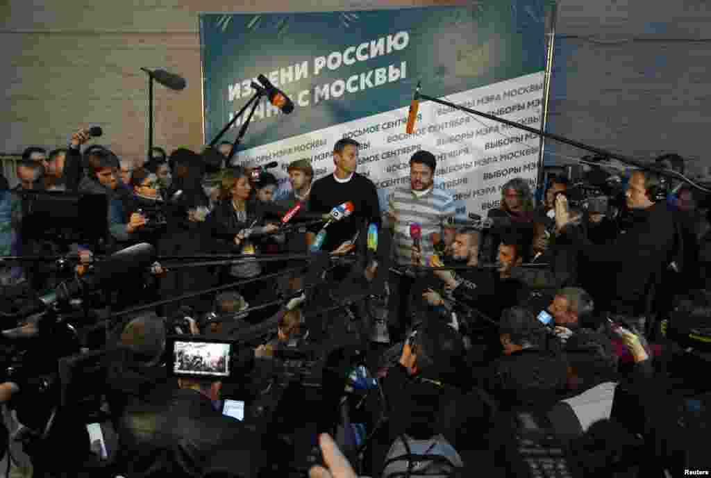 Opposition leader Alexei Navalny speaks to the media at his campaign headquarters after voting closed in the mayoral election in Moscow, Sept. 8, 2013.