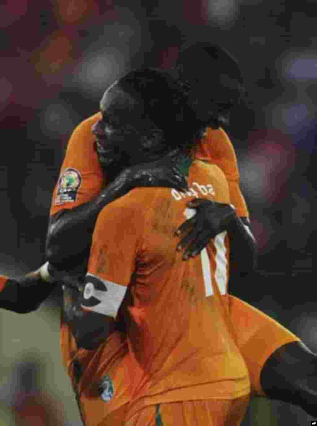 Yaya Toure (L) and Didier Drogba of Ivory Coast celebrate after scoring against Equatorial Guinea during their quarter-final match at the African Nations Cup soccer tournament in Malabo February 4, 2012.