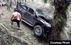 Mobil milik Jamaluddin yang ditemukan di areal perkebunan kelapa sawit milik warga di Kutalimbaru, Sumatera Utara, Jumat, 29 November 2019. (Foto courtesy: Polsek Kutalimbaru)