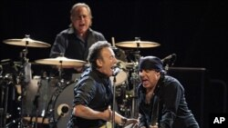 Bruce Springsteen performs with Steven Van Zandt and the E-street band April 17, 2012, in Cleveland. Max Weinberg plays the drums.