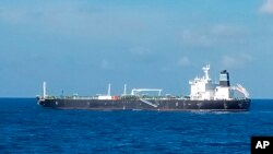 In this undated photo released by the Indonesian Navy on Wednesday, Aug. 25, 2021, the Bahamas-flagged tanker MT Strovolos is seen in the waters off Riau Islands, Indonesia. (Indonesian Navy via AP)