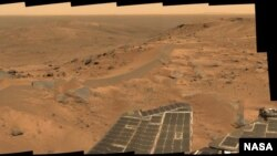 "This panorama was acquired by the Spirit Rover from a position in the ""Columbia Hills"" near the summit of ""Husband Hill."""