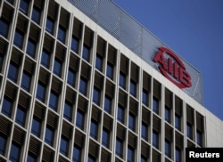 FILE - The logo of Asian Infrastructure Investment Bank (AIIB) is seen at its headquarter building in Beijing, Jan. 17, 2016.