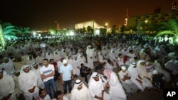 FILE - Kuwaiti citizens gather at al-Irada Square, Kuwait City, to protest against government corruption and demand transparency in government, June 10, 2014.