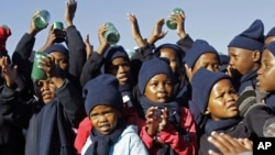 Children sing 'Happy Birthday' in honor of former South African President Nelson Mandela during celebrations for Mandela's birthday in Mvezo, South Africa, July 18, 2012.