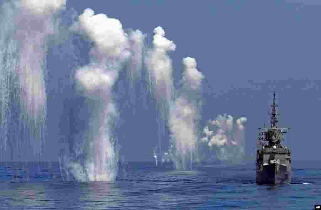 Taiwan Navy's Perry-class frigate fires chaff during the annual Han Kuang military exercises off the east coast of Hualien, central Taiwan.