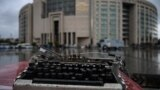 FILE - A broken typewriter is symbolicaLly displayed outside Istanbul's courthouse during a retrial of a journalist and press freedom activist on charges of supporting Kurdish militants, in Istanbul, Turkey, Sept. 30, 2021.