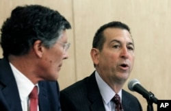FILE - CIT Group Chairman and CEO John Thain, left, and OneWest President and CEO Joseph Otting participate in a public meeting at the Los Angeles branch of the Federal Reserve Bank of San Francisco, Feb. 26, 2015.