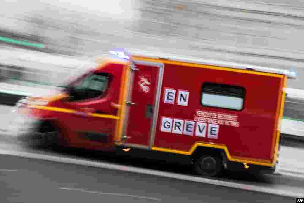 "A firemen truck reading ""on strike"" runs in Nantes, France."