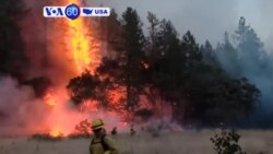 VOA60 America - Some residents in California allowed to return home as firefighters make major progress in containing wildfires