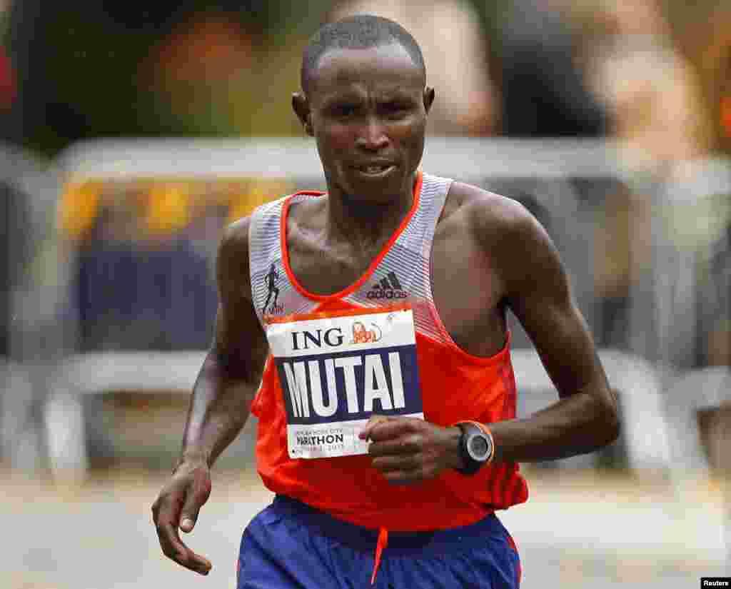 Geoffrey Mutai of Kenya runs in the New York City Marathon in New York, Nov. 3, 2013. Defending champion Mutai and Priscah Jeptoo won the men's and women's races at the New York City Marathon on Sunday for a Kenyan sweep.