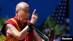he Dalai Lama delivers a speech