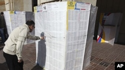 A voter searches for his name in an electoral list at a voting station in Bogota (file photo)