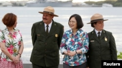 FILE - Taiwan's President Tsai Ing-wen, third from left, while en route to Pacific island allies, stands with delegates and National Park Service members at the USS Arizona Memorial at Pearl Harbor near Honolulu, Hawaii, Oct. 28, 2017.