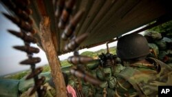 A soldier from Burundi serving with the African Union Mission in Somalia (AMISOM) is seen manning a frontline position in territory recently captured from insurgents in Deynile District along the northern fringes of the capital Mogadishu, November 18, 201
