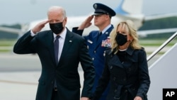 President Joe Biden returns a salute as he and first lady Jill Biden arrive at Dover Air Force Base, Del., Aug. 29, 2021.
