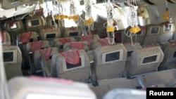 Cảnh tượng bên trong chiếc phi cơ Boeing 777 của hãng Asiana lâm nạn tại sân bay quốc tế San Francisco.