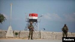 Pasukan keamanan Palestina dari faski Hamas menjaga Rafah, wilayah perbatasan Gaza dengan Mesir (foto: dok).