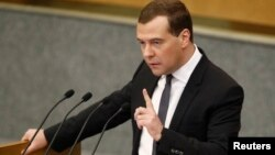 Russia's Prime Minister Dmitry Medvedev gestures during an address to the Lower House of Parliament in Moscow, April 17, 2013.