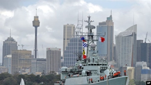 China's People's Liberation Army (PLA) naval frigate 'Mianyang' maneuvres towards the Garden Island naval base in Sydney Harbour, 20 Sep 2010