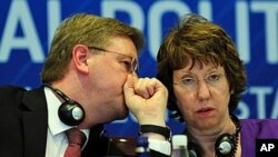 European Union High Representative for Foreign Affairs and Security Policy Catherine Ashton (R) and EU Commissioner for Enlargement Stefan Füle talk during a press conference in Istanbul, Turkey, after the Turkey-EU Ministerial Political Dialogue meeting