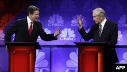Рик Перри и Рон Пол во время республиканских дебатов