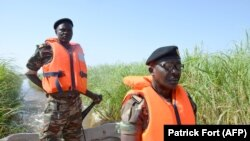 Cameroonian soldiers patrol Lake Chad on March 1, 2013 near Darak close to the Nigerian border.