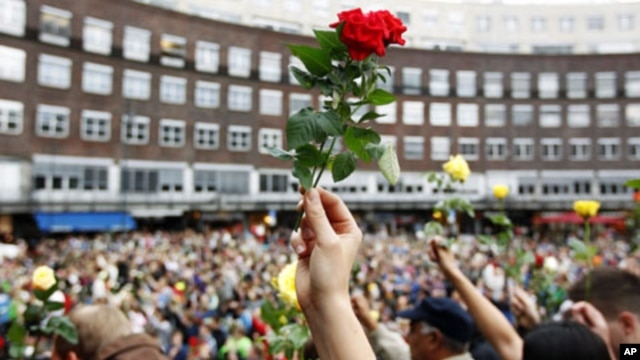 Norwegians rally in Oslo to show support for victims of attacks that killed 76 people, July 25, 2011