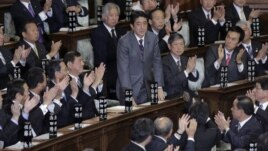Japan's Liberal Democratic Party leader Shinzo Abe bows after being named Japan's new prime minister during the plenary session at the lower house of Parliament in Tokyo, December 26, 2012.