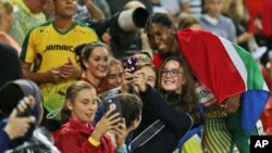 FILE: South Africa's Caster Semenya takes a selfie with fans after winning gold in the women's 1500m final at Carrara Stadium during the Commonwealth Games on the Gold Coast, Australia, April 10, 2018.