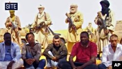 Image taken from video and provided by U.S.-based SITE Intelligence Group shows the first images of a group of foreign hostages working for a French energy company who were seized in Niger by an al-Qaida offshoot, 30 Sept. 2010
