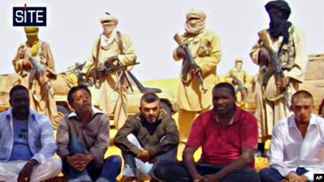 Image taken from video and provided by U.S.-based SITE Intelligence Group shows the first images of a group of foreign hostages working for a French energy company who were seized in Niger two weeks ago by an al-Qaida offshoot, according to the group that