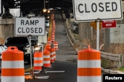 A street is closed due to work in the road in Jersey City, New Jersey, March 31, 2021.