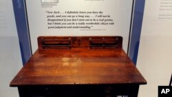 "FILE - A desk is displayed in the exhibit titled ""Young Jack"" at the John F. Kennedy Presidential Library and Museum in Boston. An archivist at Choate, the private school in Connecticut where the president studied as a boy, insists the desk didn't belong to him."