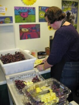 Brook Burnham prepares the daily fruit and vegetable snack at Mettawee Community School in West Pawlet, Vermont.