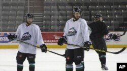 Liam Stewart, second from right, is seen during practice for the Alaska Aces hockey team in Anchorage, Alaska, Oct. 22, 2015.