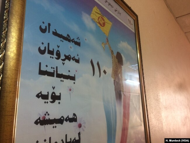 """A sign in a ruling Kurdistan Democratic Party office says: """"Martyrs, Kurdistan today is a result of your sacrifice. We will always remember you,"""" in Erbil, Kurdish Iraq, Sept. 5, 2017."""
