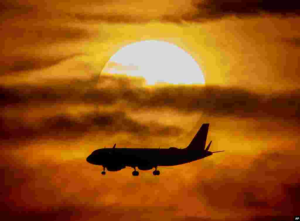 An aircraft approaches the airport as the sun sets in Frankfurt, Germany, June 15, 2019.