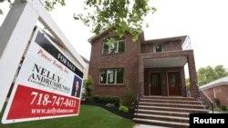 美國智庫經濟報告指,美國房地產在2015年將會回到經濟危機前水平。(資料圖片)