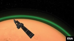 An artist's illustration depicts the ExoMars Trace Gas Orbiter, operated by the European Space Agency, has spotted daylight green oxygen around Mars for the first time. (Credit: ESA)
