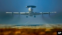 FILE - A NATO AWACS plane is seen taking off from a NATO airbase in Geilenkirchen, Germany, March 12, 2014.