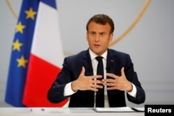 French President Emmanuel Macron responds to a question during a news conference at the Elysee Palace in Paris, April 25, 2019.