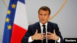 FILE - French President Emmanuel Macron responds to a question during a news conference at the Elysee Palace in Paris.
